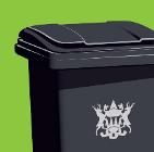 Black bin on green background