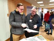 Councillors Damien Greenhalgh and Anthony Mckeown view the proposals at the exhibition