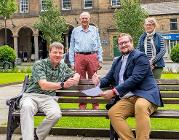 Glossop Creative Trust and the Council signing the agreement
